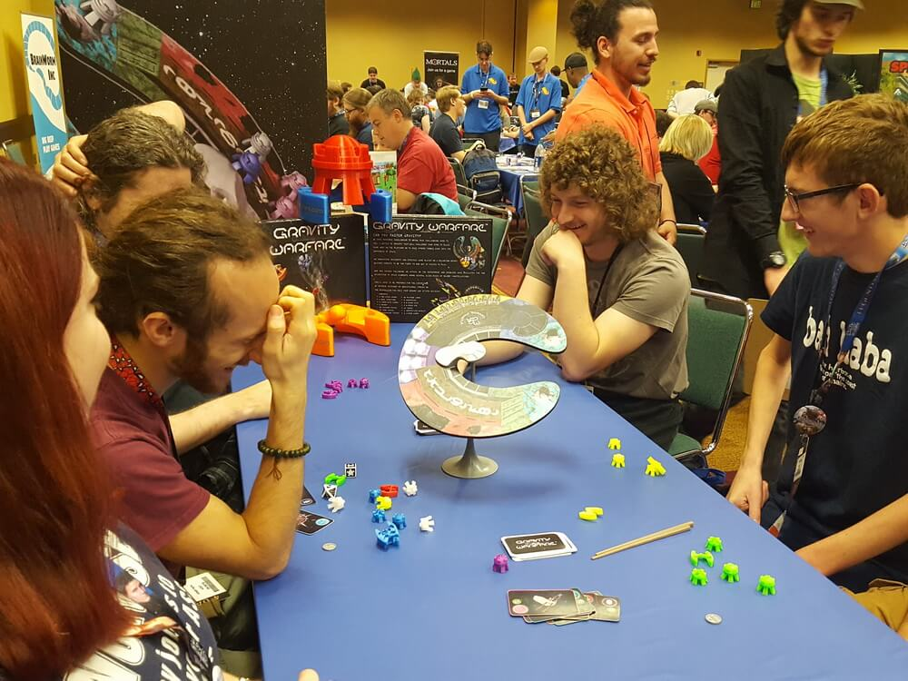 I bet you can't tell me who lost the game. Everyone is having such a good time. GenCon 2017
